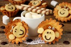 Delicious cakes in the form of a cute monkey face. Cup of coffee. With marshmallow. The idea for a children`s sweet food Stock Photography