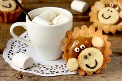 Delicious cakes in the form of a cute monkey face. Cup of coffee. With marshmallow. The idea for a children`s sweet food Royalty Free Stock Photos