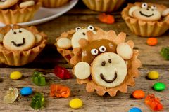 Delicious cakes in the form of a cute monkey face Stock Photos