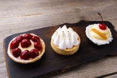 Delicious cakes. home crafted sweet desserts. Delicious assorted different mini cakes with cream and berries. home crafted sweet desserts, confectionery stock photos