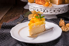 Delicious cakes with Physalis, fresh apples and cream Royalty Free Stock Image
