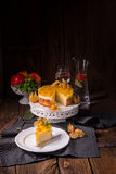 Delicious cakes with Physalis, fresh apples and cream Stock Photos