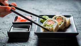 Delicious California Maki sushi made of salmon and avocado Stock Photos