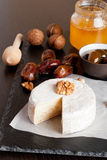 Delicious Camembert with honey and nuts. Close up, vertical Royalty Free Stock Photography