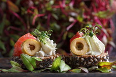 Free Delicious Canape With Salmon, Cottage Cheese, Olive With Micro Greens On A Dark Background. Cold Appetizer. Stock Photo - 95901670