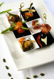 Delicious canapes. Canapes with mussel, meat and vegetables stock photography