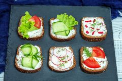 Delicious canapes with vegetables. Cucumber, radishes, lettuce a. Nd lettuce. The concept of food and vegetarianism Stock Photo
