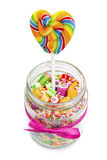 Delicious candies and lollipop in jar Royalty Free Stock Photos