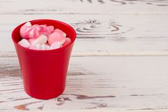 Delicious candies in red pot. stock photography