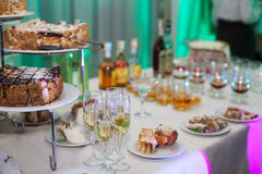 Delicious candy bar at wedding reception with cakes & champagne Stock Image