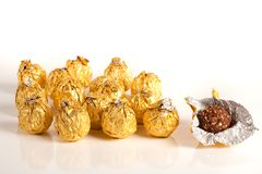 Delicious candy in golden foil Royalty Free Stock Photos