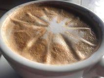 A delicious cappuccino in a Porzellan cup. Placed on a wooden table stock photos