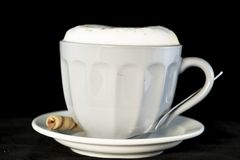 Delicious Cappuccino served with chocolate hazelnut wafer roll royalty free stock photos