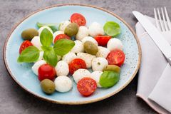 Delicious caprese salad with ripe cherry tomatoes and mini mozza Royalty Free Stock Photography