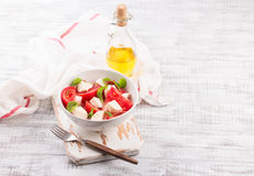 Delicious caprese salad with ripe tomatoes and mozzarella cheese with fresh basil leaves. Italian food. Stock Images