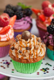 Delicious caramel and chocolate cupcake. Decorated with sweet sauce Royalty Free Stock Images