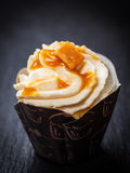 Delicious caramel cupcake Stock Images