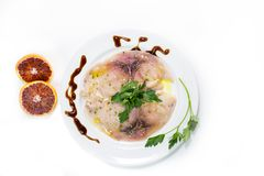 A delicious carpaccio of fresh Mediterranean swordfish. Seasoned with extra virgin olive oil, chives, parsley and a few drops of orange juice Stock Photo
