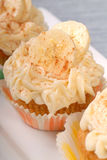 Delicious carrot cake cupcakes. With cream cheese frosting, bananas and cinnamon Stock Photo