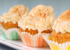 Delicious carrot cake cupcakes. With cream cheese frosting, bananas and cinnamon Stock Image
