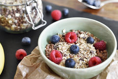 Delicious cereal breakfast with bowl and fresh fruits Royalty Free Stock Photos