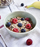Delicious cereal breakfast with bowl and fresh fruits Stock Images