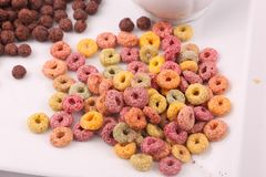 Coloured cereal - breakfast meal. Delicious cereals Brown, coloured, yellwo, orange, red Breakfast meal Whit background Top view royalty free stock image