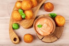 Delicious cheese balls with sauce, top view Stock Image