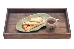 Delicious cheese blintz on green plate Stock Images
