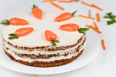 Delicious cheese cake with little carrots and Stock Image