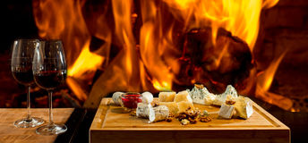 Delicious cheese at the fireplace Royalty Free Stock Photography