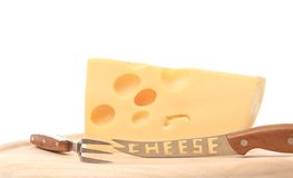 Delicious cheese with fork and knife Royalty Free Stock Photography