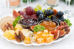 Delicious cheese and fruit plate to the holiday Stock Images