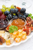 Delicious cheese and fruit plate to the holiday, closeup Stock Photos