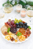 Delicious cheese and fruit plate to the holiday, top view Stock Image