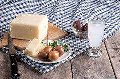 Delicious Cheese and olives on table Stock Photos