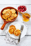 Delicious cheese pancakes on  plate Royalty Free Stock Images