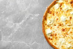 Delicious cheese pizza on grey background. Top view stock photography