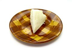 A delicious cheese on a plate on white ba Royalty Free Stock Photo