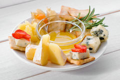 Delicious cheese plate on white table Stock Photo