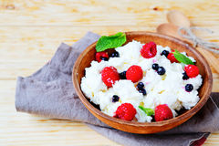 Delicious cheese with ripe berries Royalty Free Stock Image