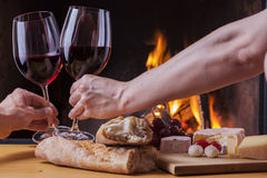 Delicious cheese and wine at the fireplace Royalty Free Stock Photos