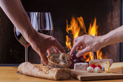 Delicious cheese and wine at the fireplace Royalty Free Stock Photo