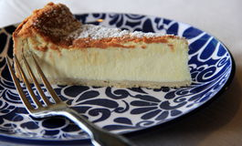 Delicious cheesecake on blue patterned plate Royalty Free Stock Image