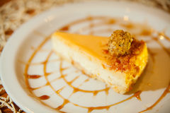 Delicious cheesecake with Caramel. On a plate Stock Photos