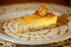 Delicious cheesecake with Caramel. On a plate Royalty Free Stock Photography