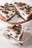 Delicious cheesecake with chocolate cookies closeup. vertical Stock Photo