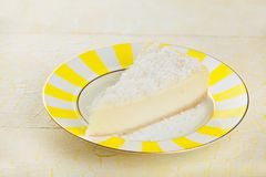 Delicious cheesecake with coconut on  plate Royalty Free Stock Photo