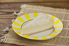 Delicious cheesecake with coconut on  plate Royalty Free Stock Photos
