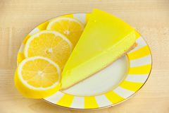 Delicious cheesecake with lemon on plate. Delicious cheesecake with lemon on a plate royalty free stock photography